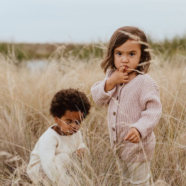 US stockist of Grown Clothing's gender neutral ribbed slub yarn cardigan in harvest gold.  Made from 100% organic cotton with a dropped shoulder and buttons down the front.