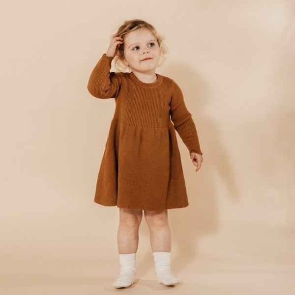 US stockist of Grown Clothing's organic cotton ribbed dress in Marigold.  Features all over rib knit, long sleeves and fun skirt.