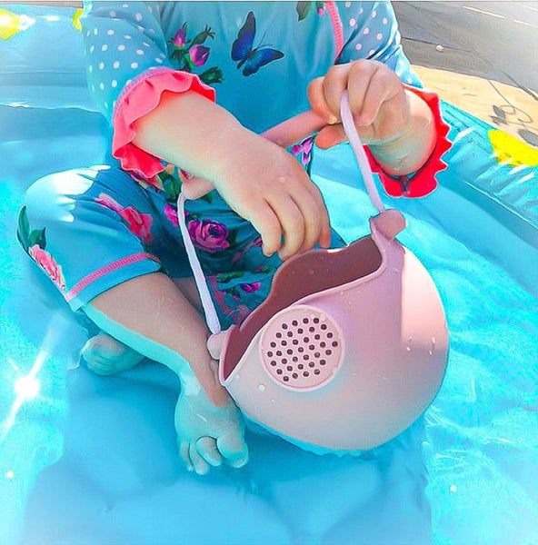 US stockist of Scrunch's dusty rose silicone watering can.