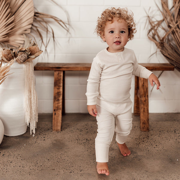 US stockist of Snuggle Hunny Kid's organic cotton jersey, halo zip footed sleeper.