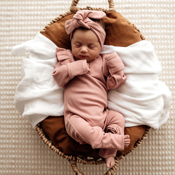 US stockist of Snuggle Hunny Kid's organic cotton jersey, rose ruffle zip footed sleeper.