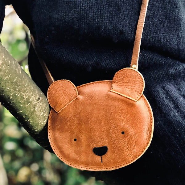 US stockist of Donsje's Bear Britta Classic Purse. Handmade from premium brown leather with an adjustable strap and zip compartment.