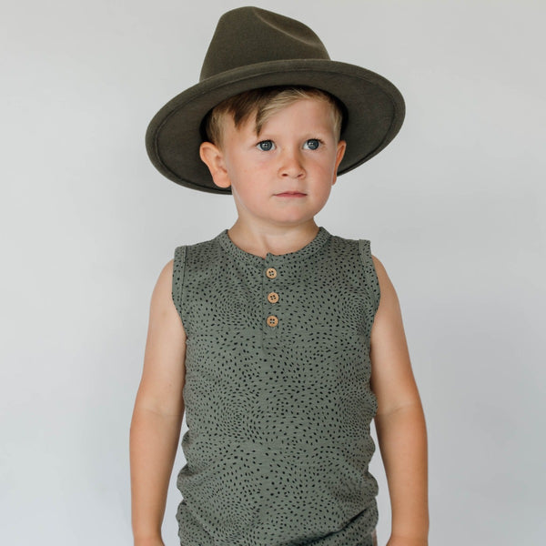 US stockist of Buck & Baa's organic dappled henley tank top.  Made from organic cotton and elastane in a blue/green color with all over spotted print. Coconut buttons on front placket.