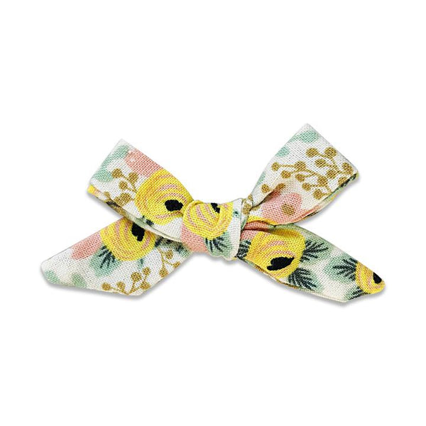 US stockist of Josie Joan's Aisha petite bow hair clip.  Cream colored fabric with pink and yellow flowers with contrasting green foilage with mustard berries.