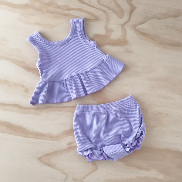US stockist of Bel & Bow's lilac ribbed cotton sleeveless peplum top and bloomers with flutter detailing on the leg and elastic waist.