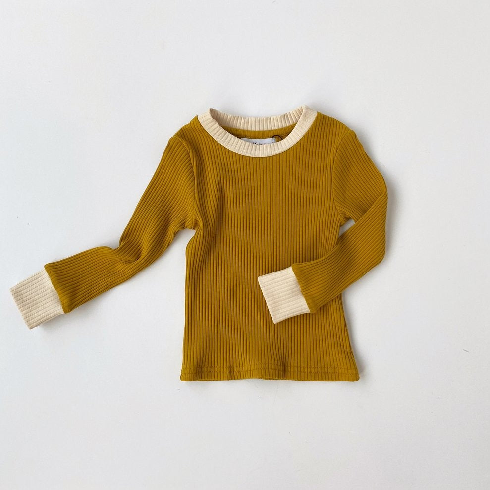 US stockist of Bel & Bow's gender neutral rich gold ribbed cotton top.  Has contrasting ribbed neckline and cuffs.