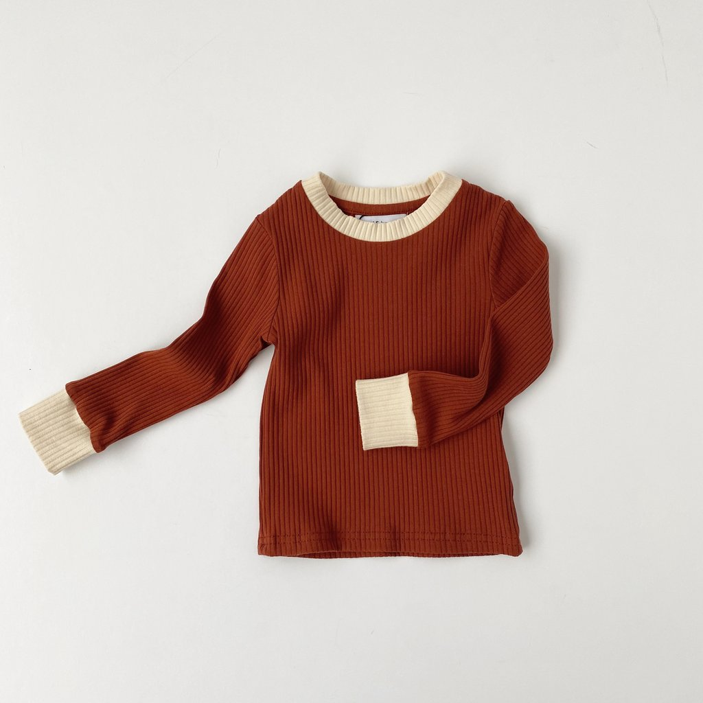 US stockist of Bel & Bow's gender neutral rich rust ribbed cotton top.  Has contrasting ribbed neckline and cuffs.