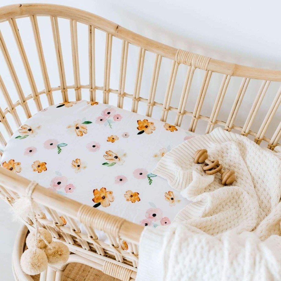 US stockist of Snuggle Hunny Kid's Poppy stretch cotton jersey bassinet sheet. White color with pink and yellow poppy print.