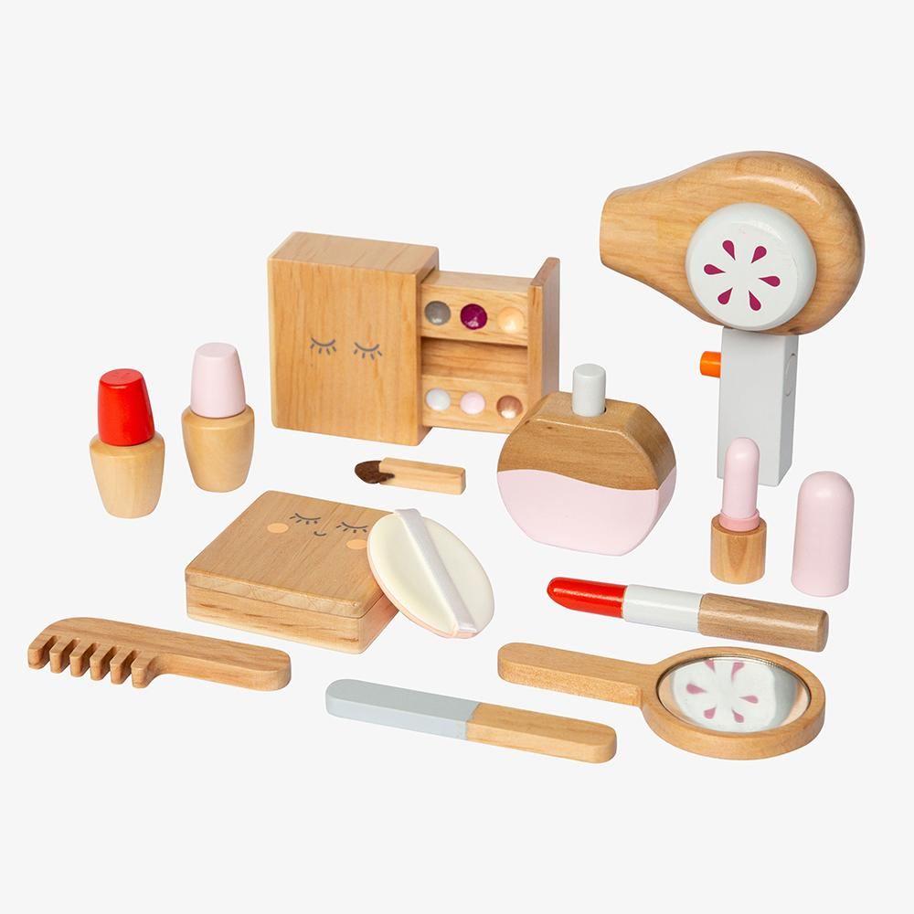 US stockist of Make Me Iconic's 11 piece wooden beauty kit.  Contains pretend play lipsticks, hair dryer, nail polishes and more.