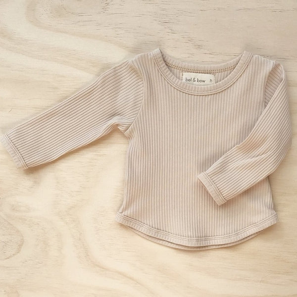 US stockist of Bel & Bow's light oatmeal long sleeve ribbed cotton top with curved hem.