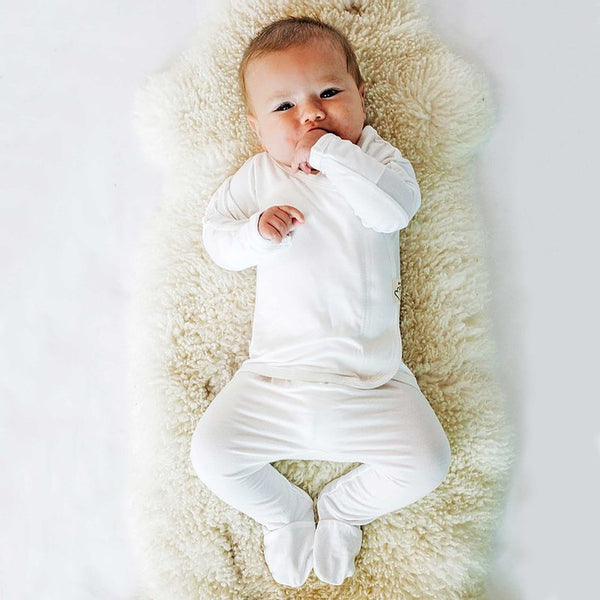 Stockist of Bonsie's rayon blend milk footie.  Top section has velcro wrap body which can be undone for skin to skin contact.  Elastic waist that can be pulled down for easy diaper changes.