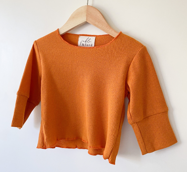 US stockist of Fable & Ford's long sleeve, gender neutral waffle top.  Made from soft 100% cotton in bronze .