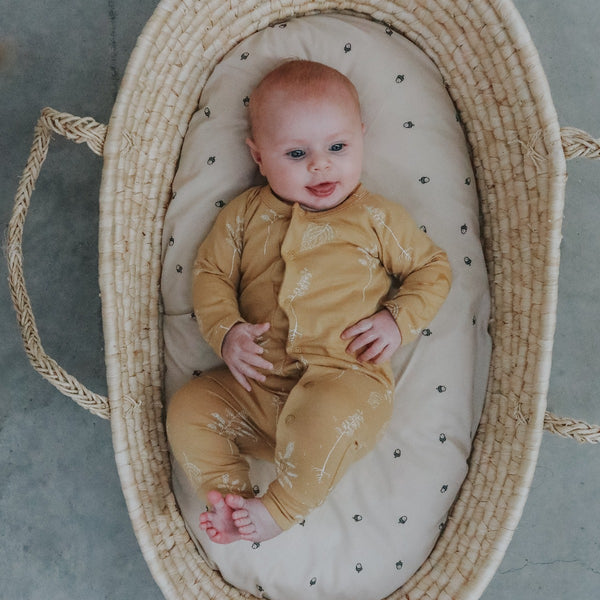 US stockist of Buck and Baa organic cotton full romper in honey with subtle constrasting white flora print
