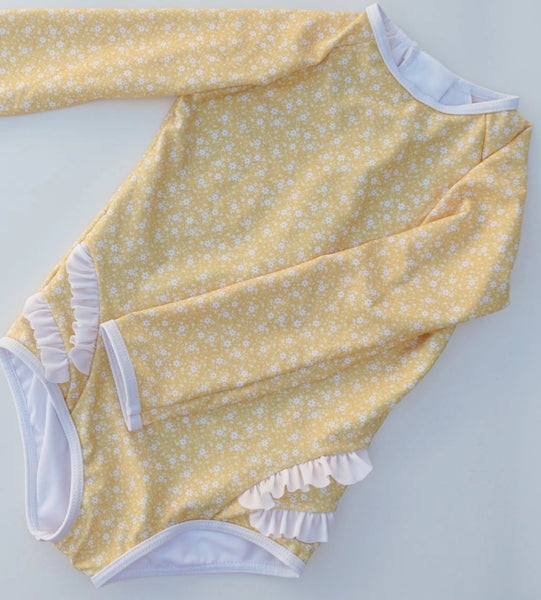 US stockist of Cocove Swim Long Sleeve Bel Rashsuit in Sunshine Yellow with delicate white floral print.