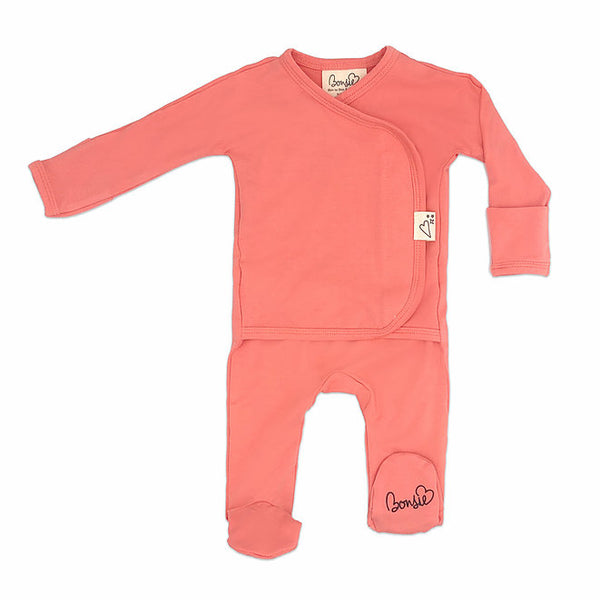 Stockist of Bonsie's rayon blend Burnt Coral footie.  Top section has velcro wrap body which can be undone for skin to skin contact.  Elastic waist that can be pulled down for easy diaper changes.