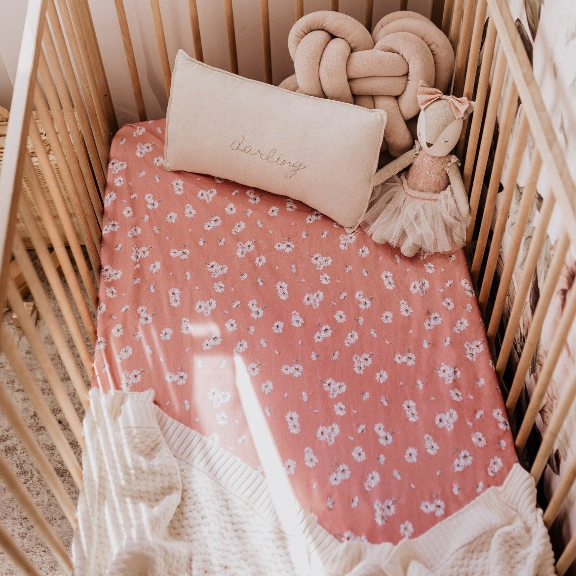 US stockist of Snuggle Hunny Kid's Daisy stretch cotton jersey crib sheet. Dusky pink color with white daisy print.