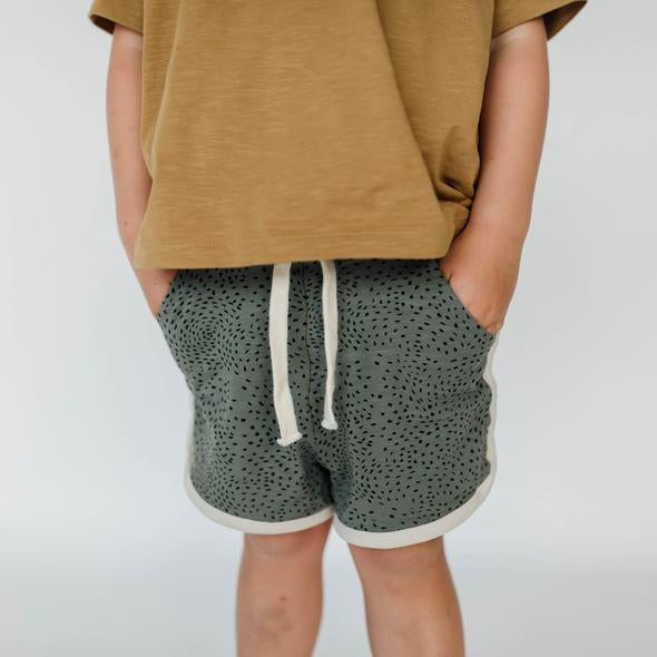 US stockist of Buck & Baa's organic cotton, gender neutral blue/green dapple shorts.  Features elastic waist with drawstring and side pockets.