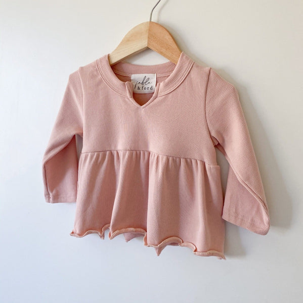 US stockist of Fable & Ford's V neck peplum top made from 100% soft ribbed cotton in dusty pink.