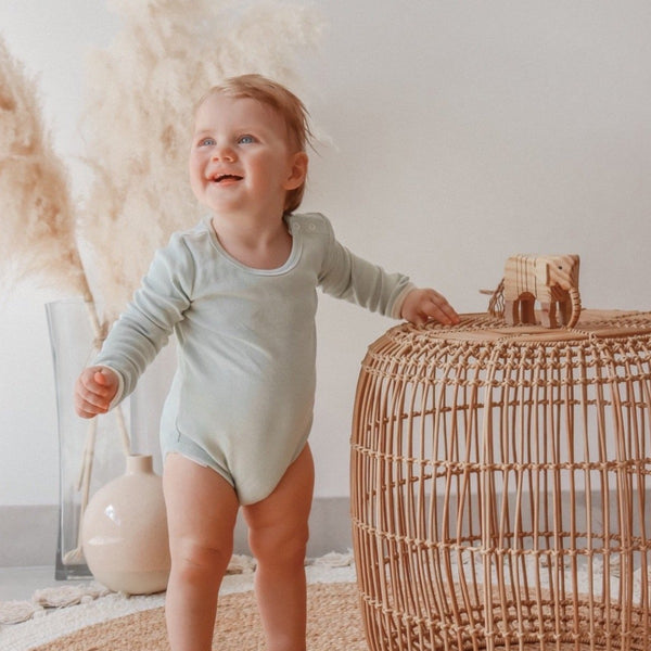 US stockist of India + Grace The Label's gender neutral, dusty sage long sleeved ribbed cotton bodysuit.  Features crotch snap.