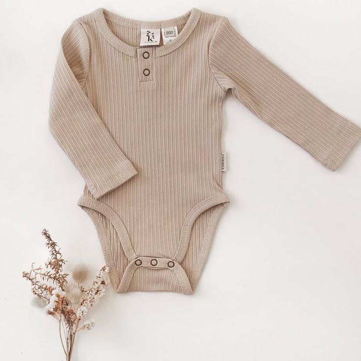 US stockist of Karibou Kids gender neutral, fawn Willow long sleeve henley bodysuit in ribbed cotton blend.