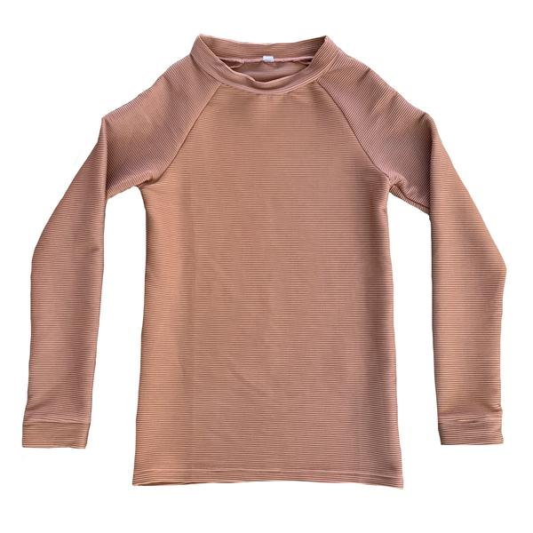 US stockist of Ruffets & Co's Finley Clay Ribbed Rash Top.  Long sleeves with cuffs at sleeves and neck; pull over style; no zips.  Made from UPF 50 + fabric.