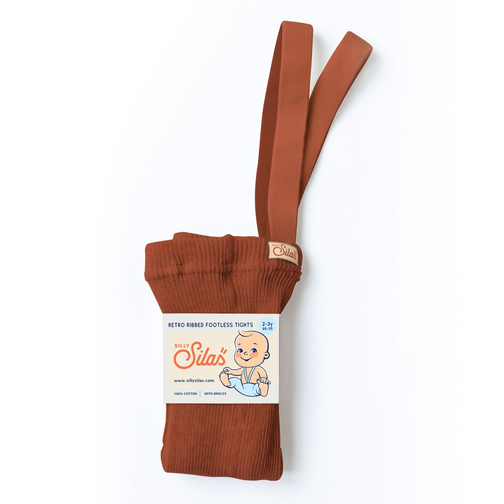 US stockist of Silly Silas gender neutral retro ribbed footed tights in cinnamon.  Made from 100% cotton and featuring braces.