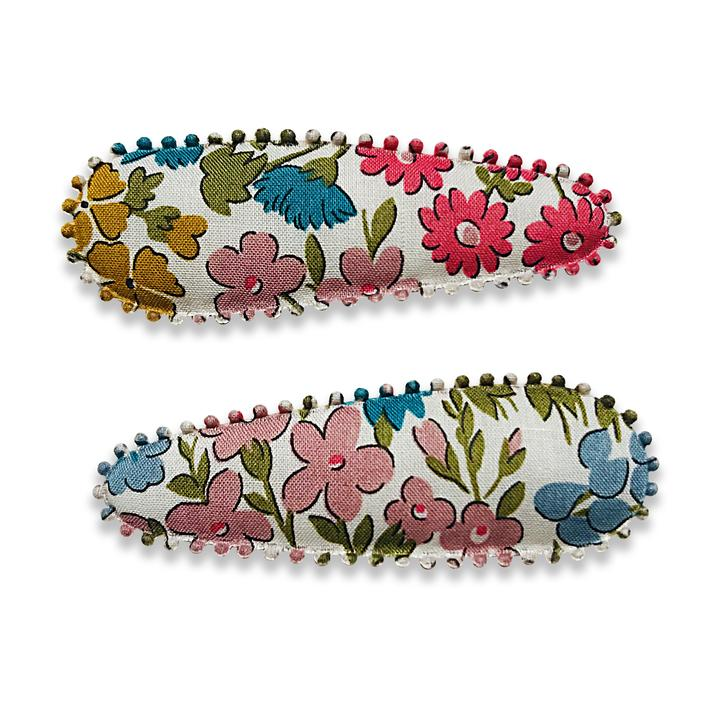 US stockist of Josie Joan's Freya hair clip set. Gorgeous white fabric with different colored flowers.