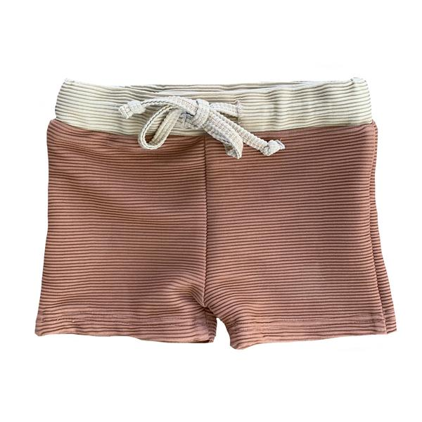 US stockist of Ruffets & Co's Grey Baby Swim Shorts.  Made from ribbed UPF 50 + fabric in a warm clay color with contrasting fawn waistband.  Features additional lining at front for extra comfort and functional drawstring at waist.