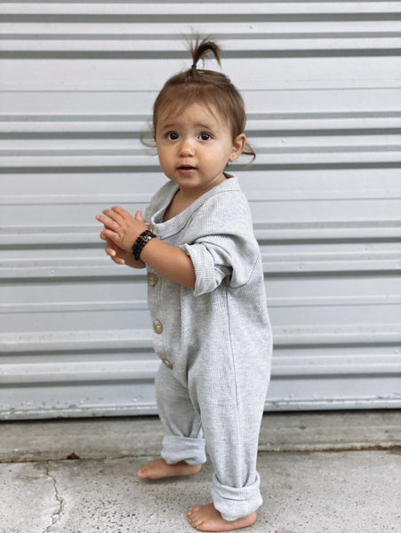 US stockist of Fable & Ford's gender neutral waffle button up romper in grey marle.  Made from 100% cotton with buttons down the front and thick cuffs.