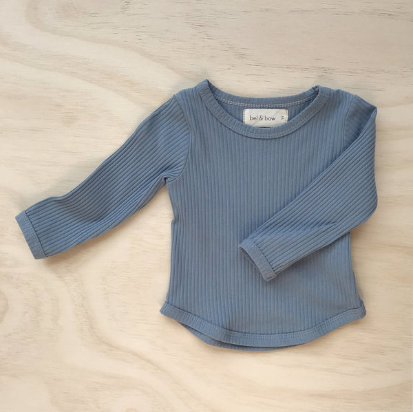 US stockist of Bel & Bow's dusty blue long sleeve ribbed cotton top with curved hem.