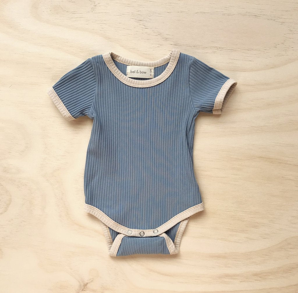 US stockist of ribbed cotton retro ringer bodysuit in dusty blue