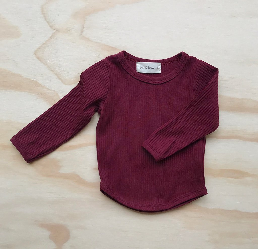 US stockist of Bel & Bow's berry long sleeve ribbed cotton top with curved hem.