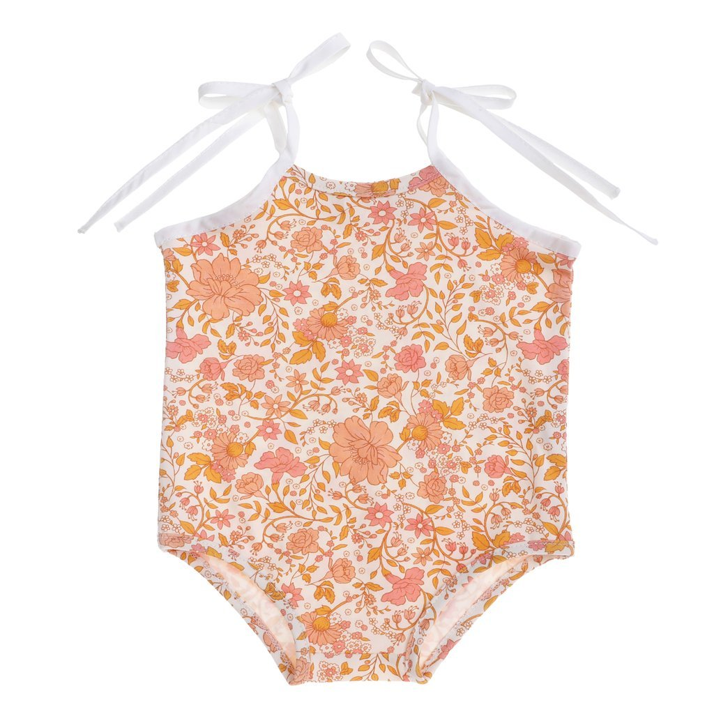 US stockist of Bonnie & Harlo's tie shoulder floral cotton bodysuit.  Beautiful floral print in hues of pink and peach with with shoulder ties and snaps at crotch.