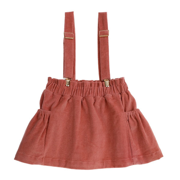 US stockist of Bonnie & Harlo's dusty pink thin cord suspender skirt with adjustable suspender straps, elastic waist and side pockets.