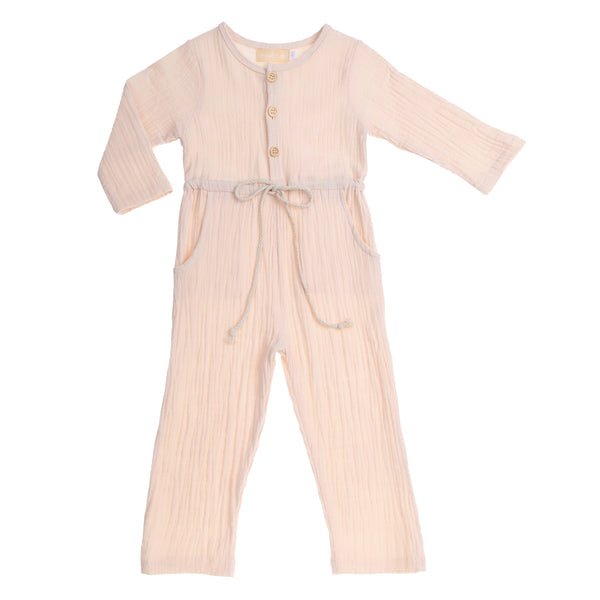 US stockist of Bonnie & Harlo's cream cotton gauze jumpsuit.  Features long sleeves, buttons down chest, elastic waist and functional drawstring.