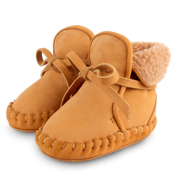 US stockist of Donsje's gender neutral Jaya baby shoe in caramel nubuck.  Handmade, moccassin style shoe, lined and with laces.
