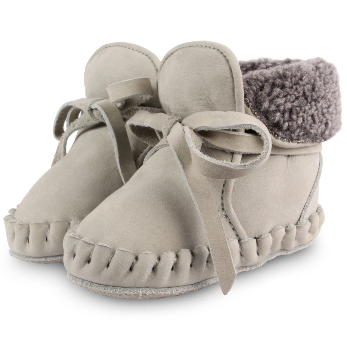 US stockist of Donsje's gender neutral Jaya baby shoe in light grey nubuck.  Handmade, moccassin style shoe, lined and with laces.