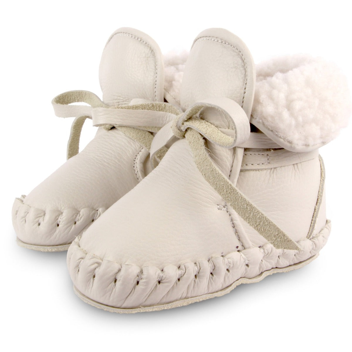 US stockist of Donsje's gender neutral Jaya baby shoe in off white leather.  Handmade, moccassin style shoe, lined and with laces.