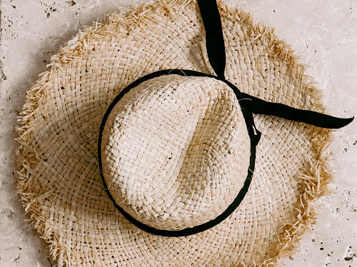 US stockist of Elle Porte's gender neutral, Barbados straw hat.  Features cut straw edging and black tie ribbon.