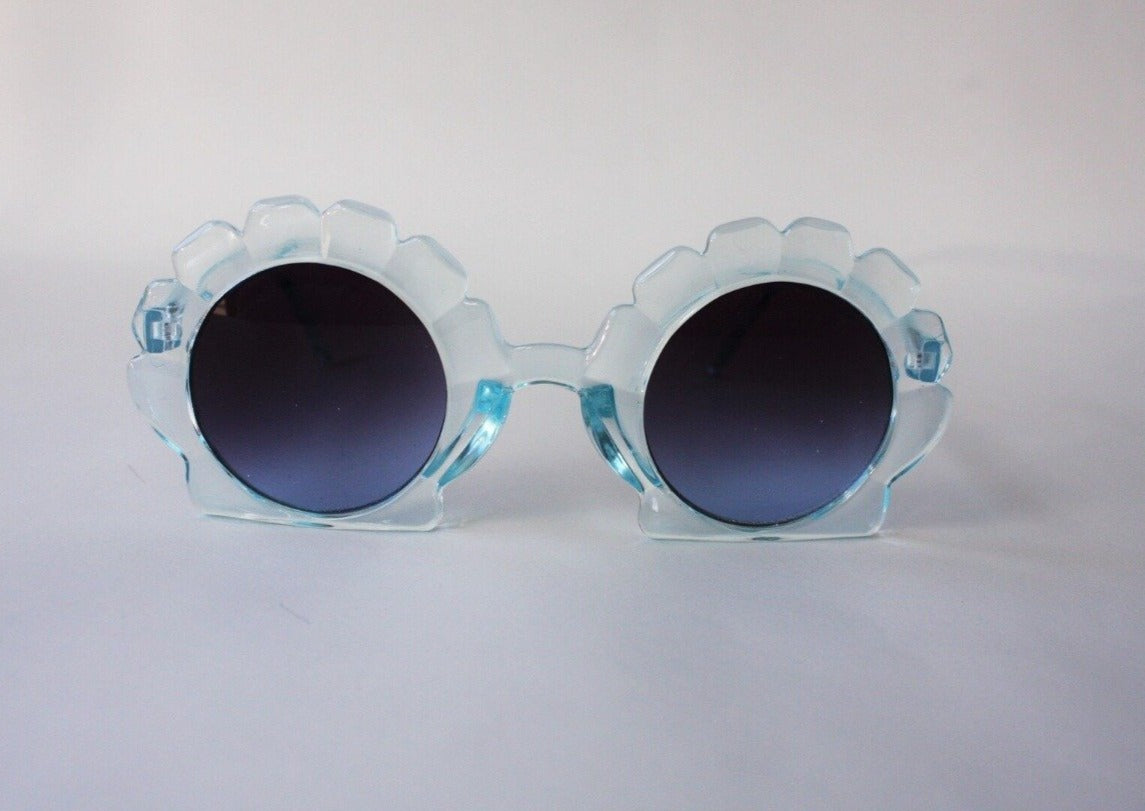 US stockist of Elle Porte's Shelly sunglasses in blue.  Shell shaped frames with dark UV 400 lenses.
