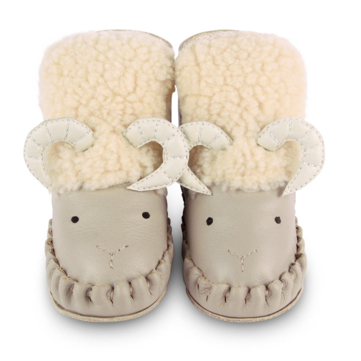 US stockist of Donsje's light grey, leather ram baby shoes with Kapi exclusive faux fur lining.  Velcro fastening - soft sole under 12mths.