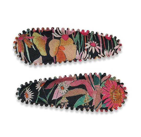US stockist of Josie Joan's Leia floral hair clip set.  Black fabric with colorful floral print.
