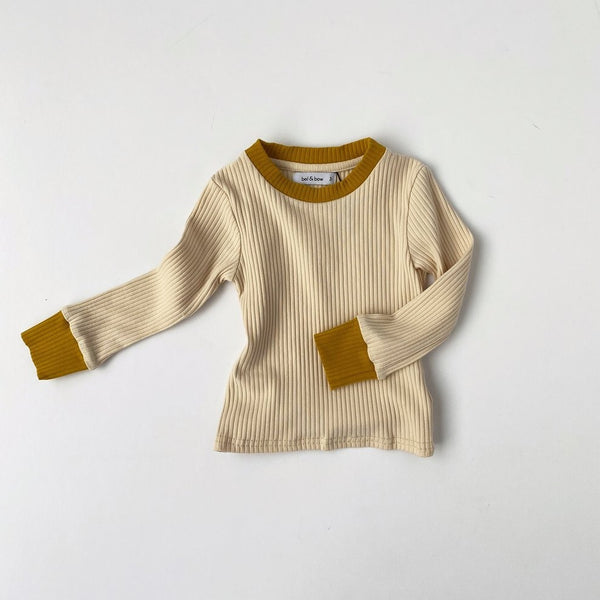US stockist of Bel & Bow's gender neutral light oatmeal ribbed cotton top.  Has contrasting ribbed neckline and cuffs in gold.