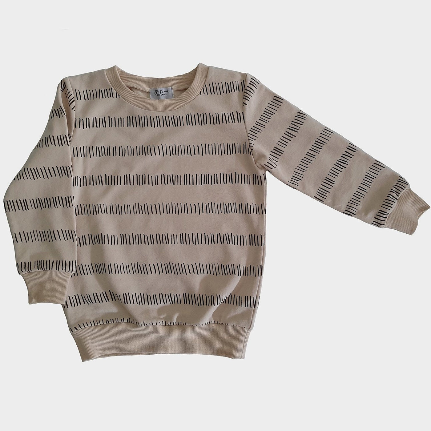 US stockist of Oh Nine The Label's cream and black line sweatshirt.  100% brushed cotton.