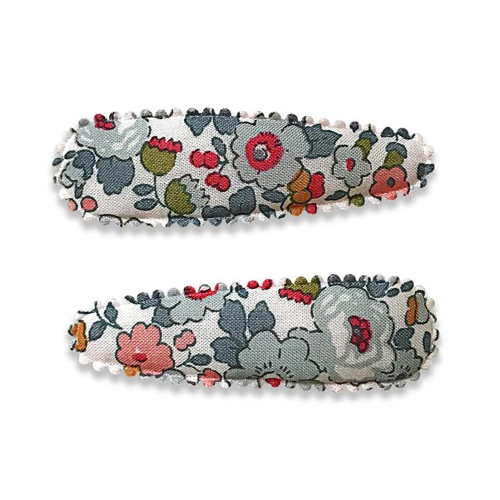 US stockist of Josie Joan's Little Izzy Baby hair clip set. Gorgeous white fabric with grey, red, mustard and pink flowers.