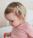 US stockist of Josie Joan's Little Maureen baby hair clip set. Gorgeous cream fabric with blue, pink, red or yellow flowers.