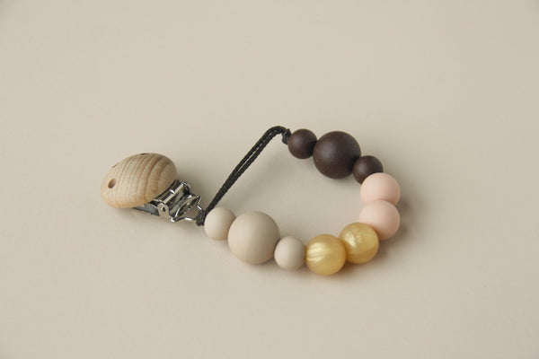 US stockist of Little Chew Silicone golden mini pacifier clip