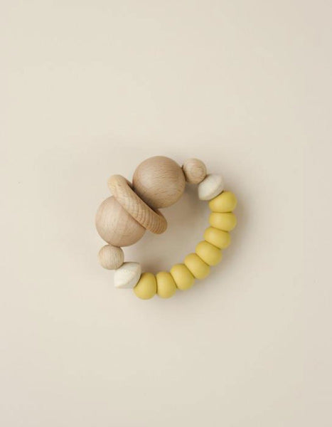 US stockist of Little Chew silicone + wood smiley mustard teether