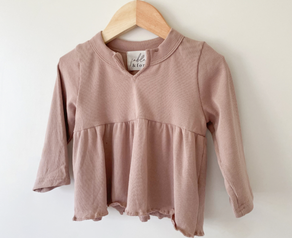 US stockist of Fable & Ford's V neck peplum top made from 100% soft ribbed cotton in mulberry.
