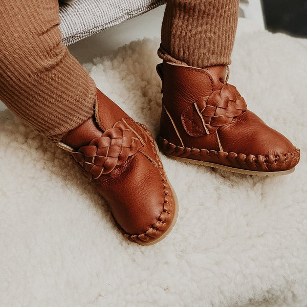 US stockist of Donsje's Cognac classic leather  baby shoes with Mace faux fur lining.  Velcro braided fastening - soft sole under 12mths.